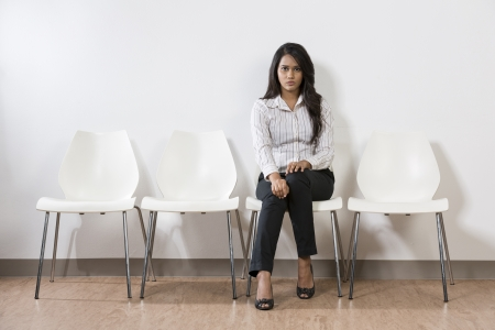 edgy: Nervous looking Indian business woman waiting for someone.