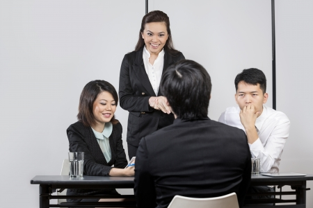 applicant: Panel of Chinese colleagues from hr department interview a male applicant.