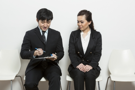 Chinese business man interviewing a female applicant. photo