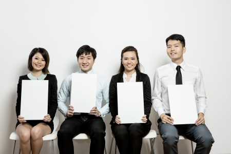 committee: Panel of Business judges hold up blank score cards for your message. Stock Photo