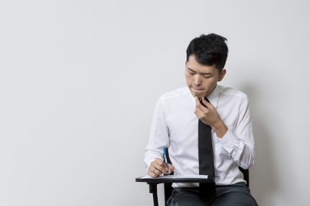 Chinese male student or business man taking an exam test photo
