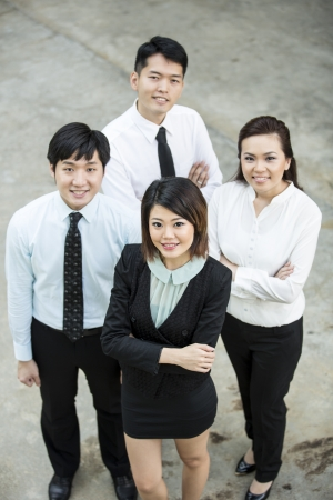 Chinese Business woman standing with her colleagues in the background. Stock Photo - 16771732