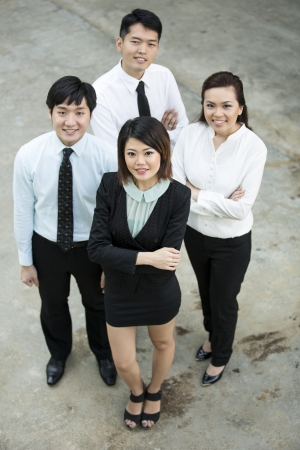 Happy Asian Business colleagues looking up and smiling. Stock Photo - 16771845