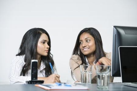 Indian business woman in office working together. photo