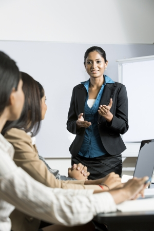 presentation board: Indian business woman giving a presentation for her business colleagues.