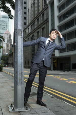 lamp post: Chinese Businessman looking to the future. Concept about an Asian Business executive looking to the future.
