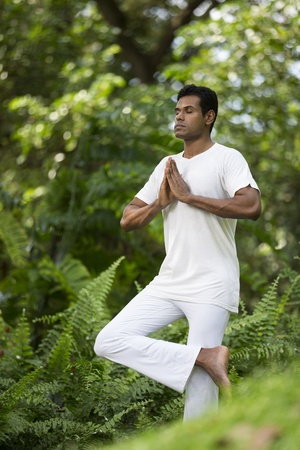 Portrait of handsome Indian man doing yoga exercise in park Stock Photo - 19590158