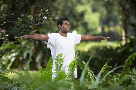 Portrait of handsome Indian man doing yoga exercise in park Stock Photo - 19590161