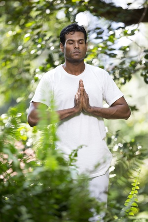 Portrait of handsome Indian man doing yoga exercise in park Stock Photo - 19590157