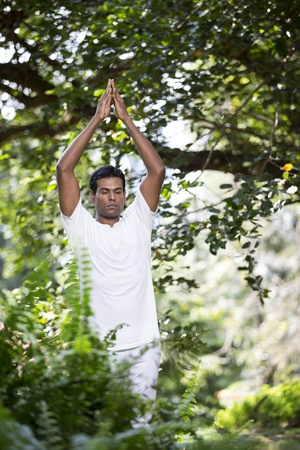 Portrait of handsome Indian man doing yoga exercise in park Stock Photo - 19590168
