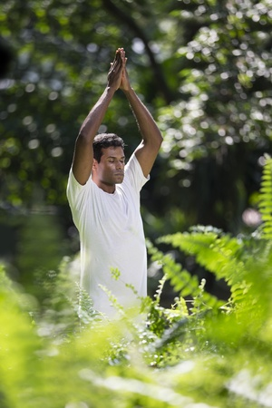 Portrait of handsome Indian man doing yoga exercise in park Stock Photo - 19590151