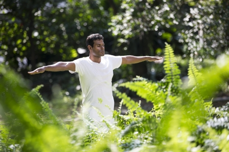 Portrait of handsome Indian man doing yoga exercise in park Stock Photo - 19590155