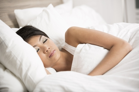 Portrait of a beautiful young Chinese female sleeping in bed at home Stock Photo - 19687018