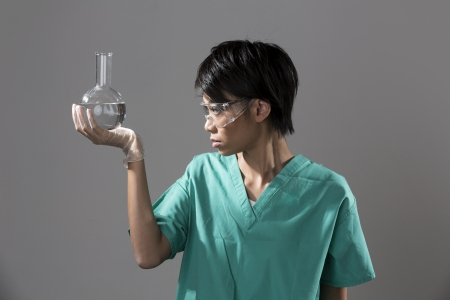 Female Chinese Healthcare professional or scientific researcher holding a round-bottomed flask photo