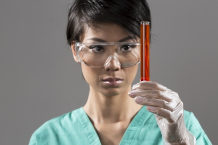 Female Chinese Healthcare professional or scientific researcher holding a test tube photo
