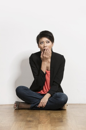 Beautiful Chinese woman looking tired and Yawning. Asian business woman Yawning.  photo
