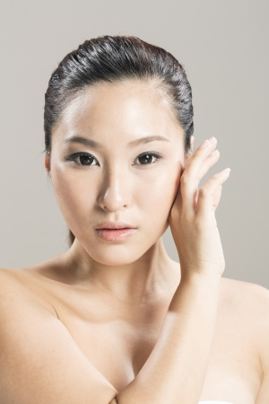 Head and shoulders Portrait of a beautiful Chinese female model. photo