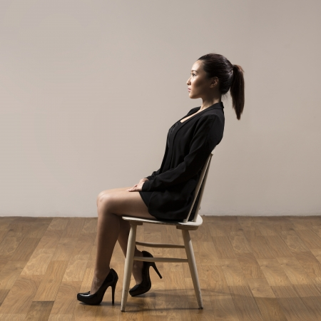 Side view of a Chinese Business woman sitting on a chair photo