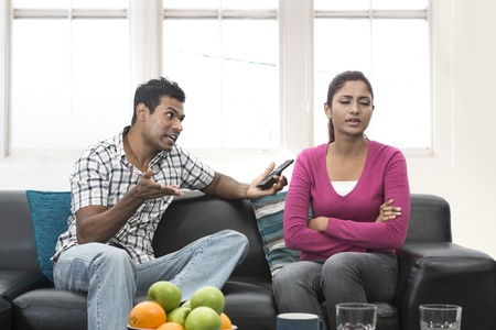 people arguing: Angry Indian couple having an argument in their living room