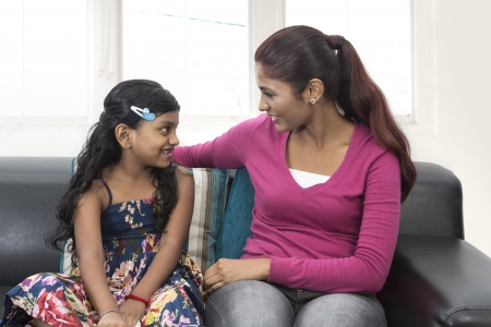 Young Indian mum and little daughter at home together photo