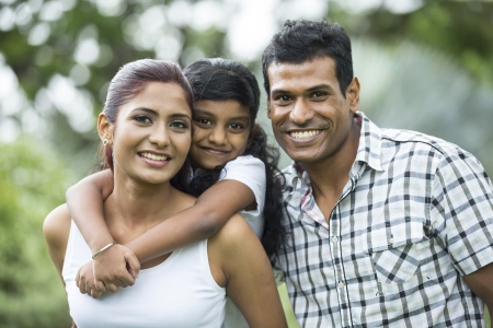 family park: Happy Indian family. Father, mother and daughter in the park