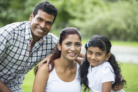 indian family: Happy Indian family. Father, mother and daughter in the park