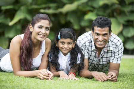indian summer: Happy Indian family. Father, mother and daughter in the park