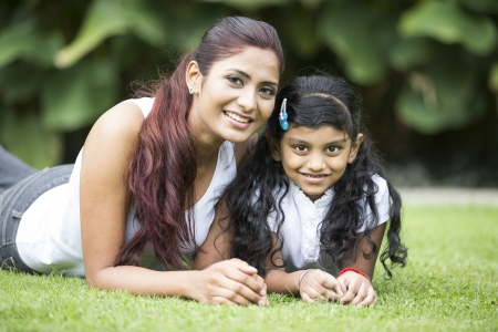 indian summer seasons: Happy Indian mother and daughter playing in the park. Lifestyle image. Stock Photo