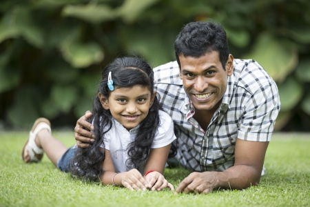indian family: Happy Indian Father and daughter playing in the park. Lifestyle image. Stock Photo