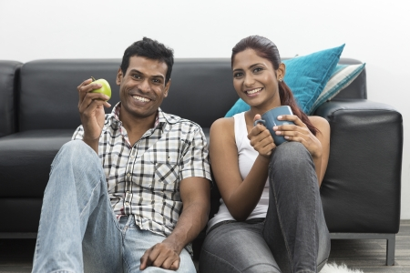 Portrait a happy young Indian couple relaxing at home  photo