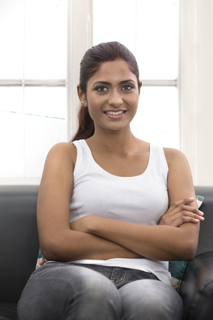 Portrait of beautiful Indian woman relaxing at home photo