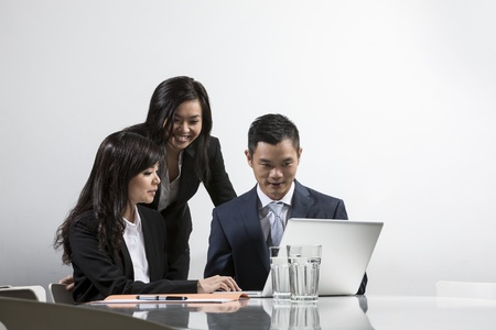 Group of Chinese business people having a meeting together Stock Photo - 20056720