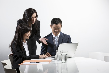modern business lady: Group of Chinese business people having a meeting together Stock Photo