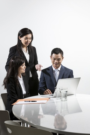 Group of Chinese business people having a meeting together Stock Photo - 20057645