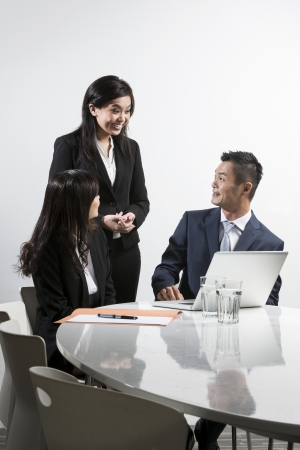 Group of Chinese business people having a meeting together Stock Photo - 20057658