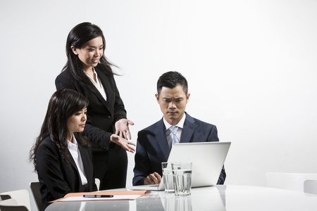 displeased businessman: Group of Chinese unhappy business people having a meeting together