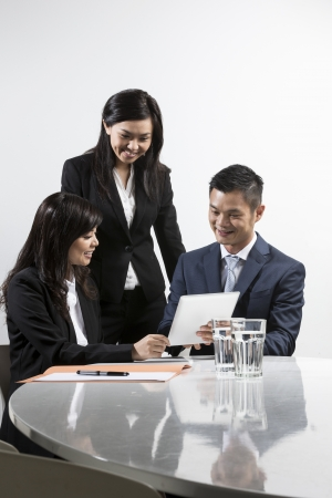 Group of Chinese business people having meeting together Stock Photo - 20058057