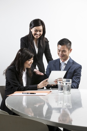asian businessman: Group of Chinese business people having meeting together Stock Photo