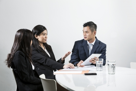 asian office lady: Group of Chinese business people having meeting together Stock Photo
