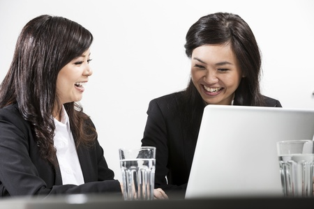 Two Chinese business women people having a meeting together Stock Photo - 20058038