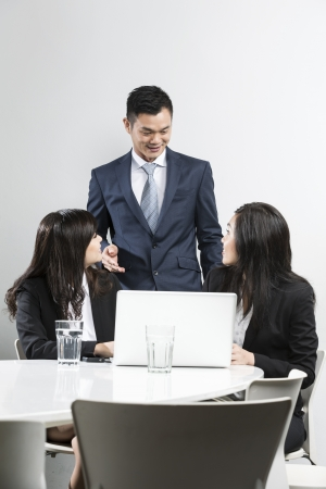 Group of Chinese business people having a meeting together Stock Photo - 20058041