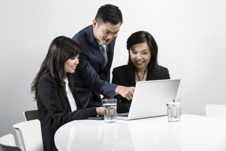 Group of Chinese business people having a meeting together Stock Photo - 20057602