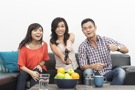 Group of Young Chinese friends playing video games at home Stock Photo - 20057744