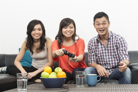 Group of Young Chinese friends playing video games at home  Stock Photo - 20057898