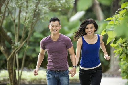Young Chinese Couple having fun in park Stock Photo - 20056784