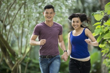 Young Chinese Couple having fun in park photo