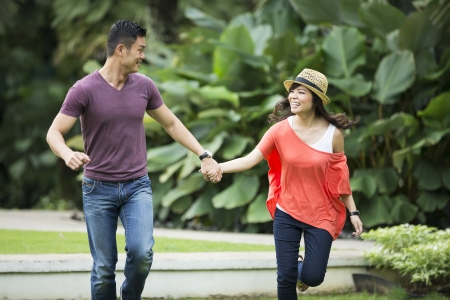 women having fun: Young Chinese Couple having fun in park