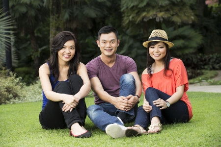 Group of Happy Chinese friends having fun outdoors photo