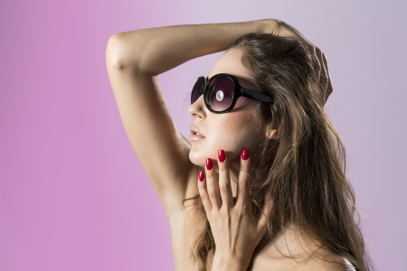 Portrait of a Beautiful fashion model wearing sunglasses  photo