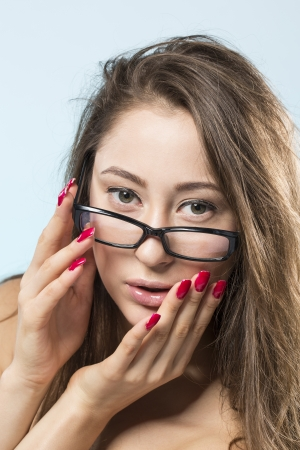 Portrait of a Beautiful fashion model wearing glasses  photo